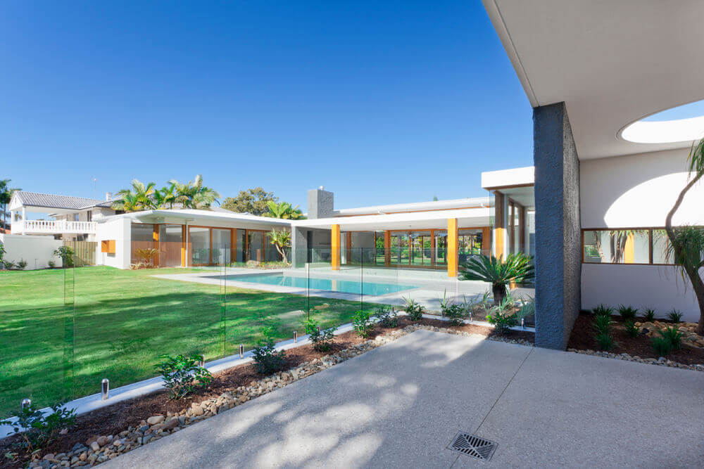 huge luxury backyard with a pool featuring a classy glass pool fence built by pool fencing Toowoomba