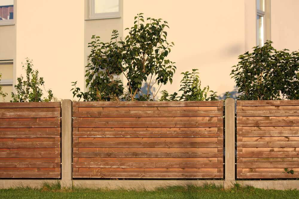 mix of concrete fencing and timber fence sections
